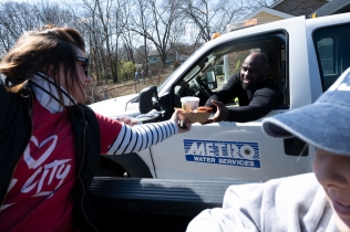 Members of Wounded Warriors, AGAPE, and the West Nashville Dream Center distribute hot meals to relief workers and families after the recent tornado in North Nashville, Tennessee.