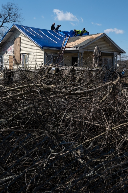 Construction workers repair a house damaged by a tornado in North Nashville, Tennessee.